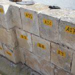 סימון ופירוק אבנים בממילא ירושלים, לצורך הרכבה מחדש.
